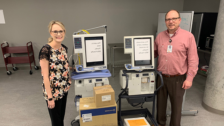 Darrin French, Director of Respiratory Care Services at United Regional, and Jennifer Anderson, Department of Respiratory Care Chair at MSU Texas, stand with two ventilators on loan to URHCS and personal protective equipment which was donated.